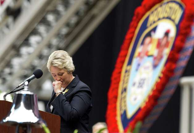 Houston Mayor Annise Parker pauses during her speech during a memorial service honoring Houston firefighters Robert Bebee, Robert Garner, Matthew Renaud, and Anne Sullivan at Reliant Stadium Wednesday, June 5, 2013, in Houston. The four firefighters died in a 5-alarm fire while searching for people they thought might be trapped inside a burning motel and restaurant last Friday. Photo: Brett Coomer, Houston Chronicle / © 2013  Houston Chronicle