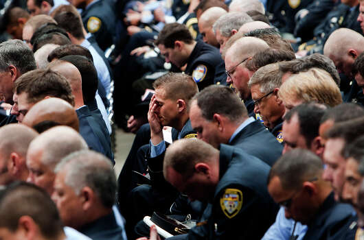 Firefighters react during a memorial service honoring four Houston firefighters at Reliant Stadium Wednesday, June 5, 2013. In Houston. Four firefighters died when a part of a building collapsed on them while they were searching for people they thought might be trapped inside a burning motel and restaurant last Friday. Photo: Cody Duty, Houston Chronicle / © 2013 Houston Chronicle