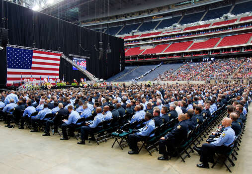 Firefighters listen during a memorial service honoring four Houston firefighters at Reliant Stadium Wednesday, June 5, 2013. In Houston. Four firefighters died when a part of a building collapsed on them while they were searching for people they thought might be trapped inside a burning motel and restaurant last Friday. Photo: Cody Duty, Houston Chronicle / © 2013 Houston Chronicle