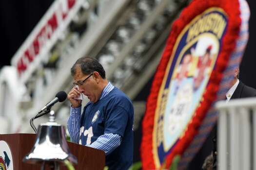 Tony Rocha, uncle of fallen firefighter Capt. Matthew Renaud, pauses during his tribute to his nephew during a memorial service honoring Houston firefighters Robert Bebee, Robert Garner, Matthew Renaud, and Anne Sullivan at Reliant Stadium Wednesday, June 5, 2013, in Houston. The four firefighters died in a 5-alarm fire while searching for people they thought might be trapped inside a burning motel and restaurant last Friday. Photo: Brett Coomer, Houston Chronicle / © 2013  Houston Chronicle