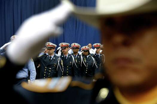 Honor Guard members salute during a memorial service honoring Houston firefighters Robert Bebee, Robert Garner, Matthew Renaud, and Anne Sullivan at Reliant Stadium Wednesday, June 5, 2013, in Houston. The four firefighters died in a 5-alarm fire while searching for people they thought might be trapped inside a burning motel and restaurant last Friday. Photo: Brett Coomer, Houston Chronicle / © 2013  Houston Chronicle