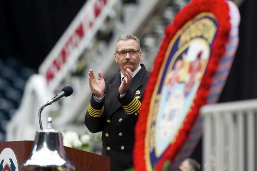 Houston fire chief Terry Garrison applauds during a memorial service honoring Houston firefighters Robert Bebee, Robert Garner, Matthew Renaud, and Anne Sullivan at Reliant Stadium Wednesday, June 5, 2013, in Houston. The four firefighters died in a 5-alarm fire while searching for people they thought might be trapped inside a burning motel and restaurant last Friday. Photo: Brett Coomer, Houston Chronicle / © 2013  Houston Chronicle