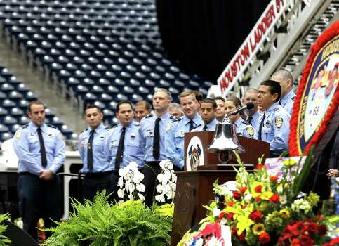 Sr. Capt. Simon Hernandez, far right, speaks during a memorial service honoring Houston firefighters Robert Bebee, Robert Garner, Matthew Renaud, and Anne Sullivan at Reliant Stadium Wednesday, June 5, 2013, in Houston. The four firefighters died in a 5-alarm fire while searching for people they thought might be trapped inside a burning motel and restaurant last Friday. Photo: Brett Coomer, Houston Chronicle / © 2013  Houston Chronicle