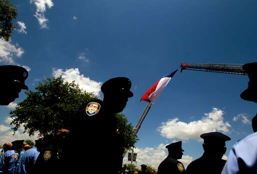 Firefighters leave a memorial service honoring four Houston firefighters at Reliant Stadium Wednesday, June 5, 2013. In Houston. Four firefighters died when a part of a building collapsed on them while they were searching for people they thought might be trapped inside a burning motel and restaurant last Friday. Photo: Cody Duty, Houston Chronicle / © 2013 Houston Chronicle