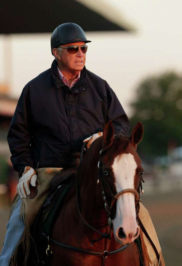 Trainer D. Wayne Lukas rides his pony on the track, Tuesday, June 4, 2013 at Belmont Park in Elmont, N.Y. Preakness winner Oxbow, trained by Likas,  is entered in Saturday's Belmont Stakes horse race. (AP Photo/Mark Lennihan) Photo: Mark Lennihan