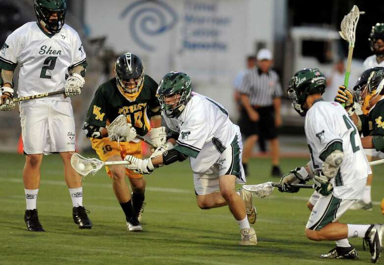 Shen's Pete Sacks advances the ball during the Class A boys' lacrosse state semifinal game against W