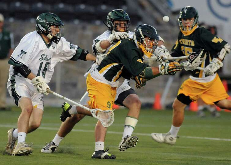 Shenendehowa and Ward Melville players battle for the ball during the Class A boys' lacrosse state s