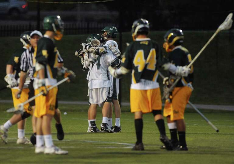 Shen players celebrate after a goal during their Class A boys' lacrosse state semifinal game against
