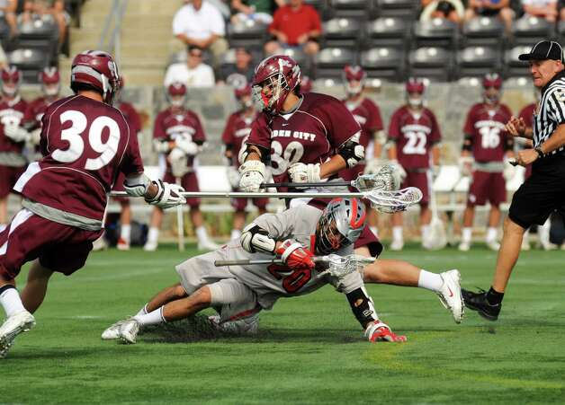 Niskayuna's Tyler Pantalone maintains control of the ball after winning a face off during their 10-9 loss to  Garden City in the Class B boys' lacrosse state semifinal at Marist College on Wednesday June 5, 2013 in Poughkeepsie, N.Y.  (Michael P. Farrell/Times Union) Photo: Michael P. Farrell