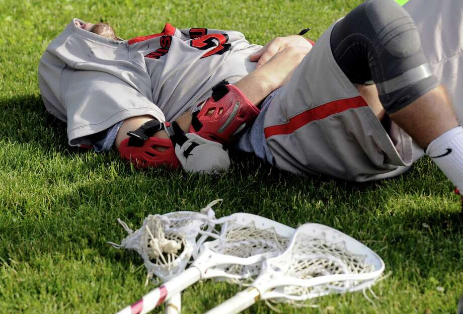 Niskayuna's Lucas Maloney lays with his jersey covering his face as Garden City defeated Niskayuna 10-9 in the Class B boys' lacrosse state semifinal at Marist College on Wednesday June 5, 2013 in Poughkeepsie, N.Y.  (Michael P. Farrell/Times Union) Photo: Michael P. Farrell