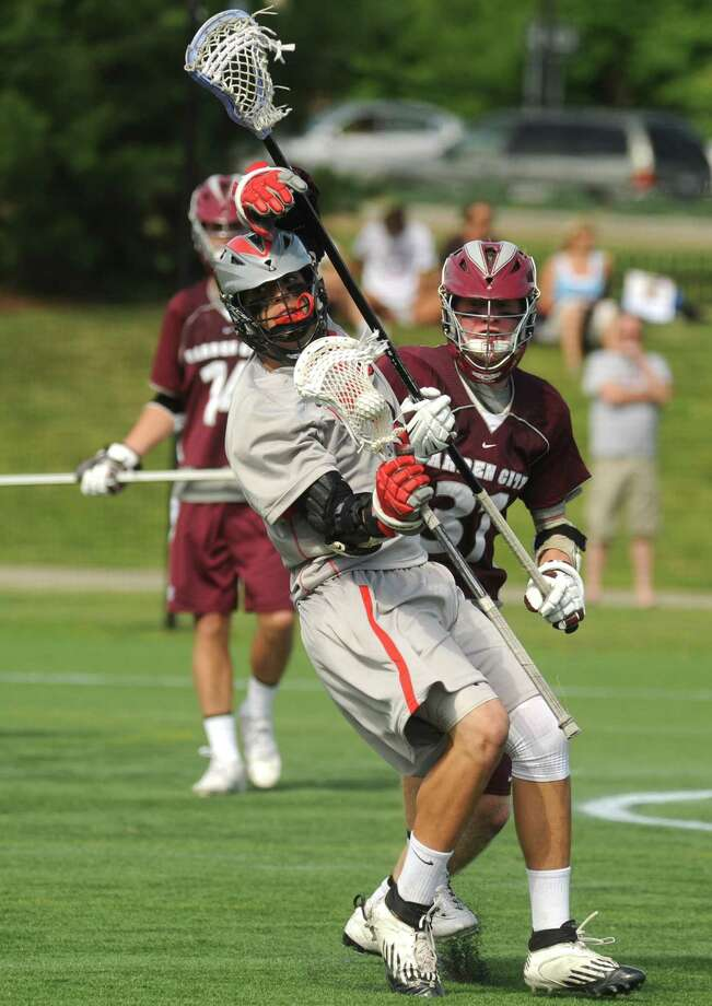 Niskayuna's Lucas Maloney works his way around a Garden City defender during their 10-9 loss to   in the Class B boys' lacrosse state semifinal at Marist College on Wednesday June 5, 2013 in Poughkeepsie, N.Y. (Michael P. Farrell/Times Union) Photo: Michael P. Farrell