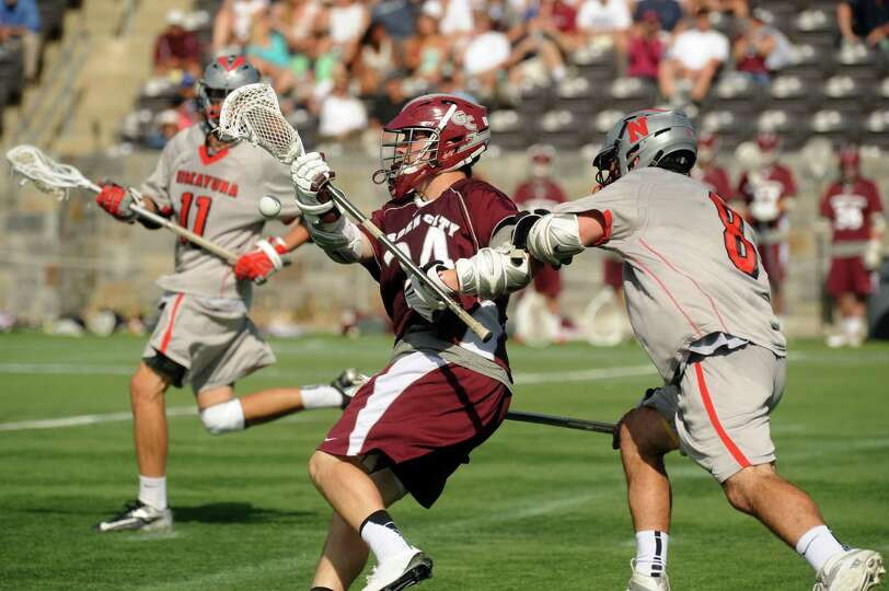 Niskayuna's Aidan O'Brien knocks the ball away from Carden City's Tim McDonagh during their 10-9 los