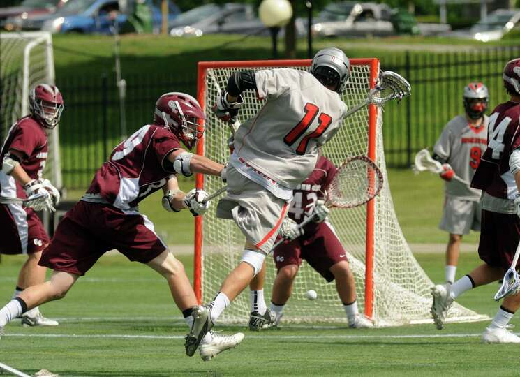 Niskayuna's John Prendergast scores a goal during a 10-9 loss to Garden City in the Class B boys' la