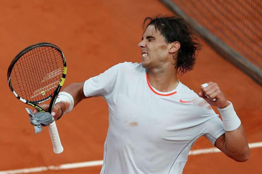 Spain's Rafael Nadal celebrates defeating Switzerland's Stanislas Wawrinka in three sets 6-2, 6-3, 6-1, in their quarterfinal match at the French Open tennis tournament, at Roland Garros stadium in Paris, Wednesday June 5, 2013. (AP Photo/Petr David Josek) Photo: Petr David Josek