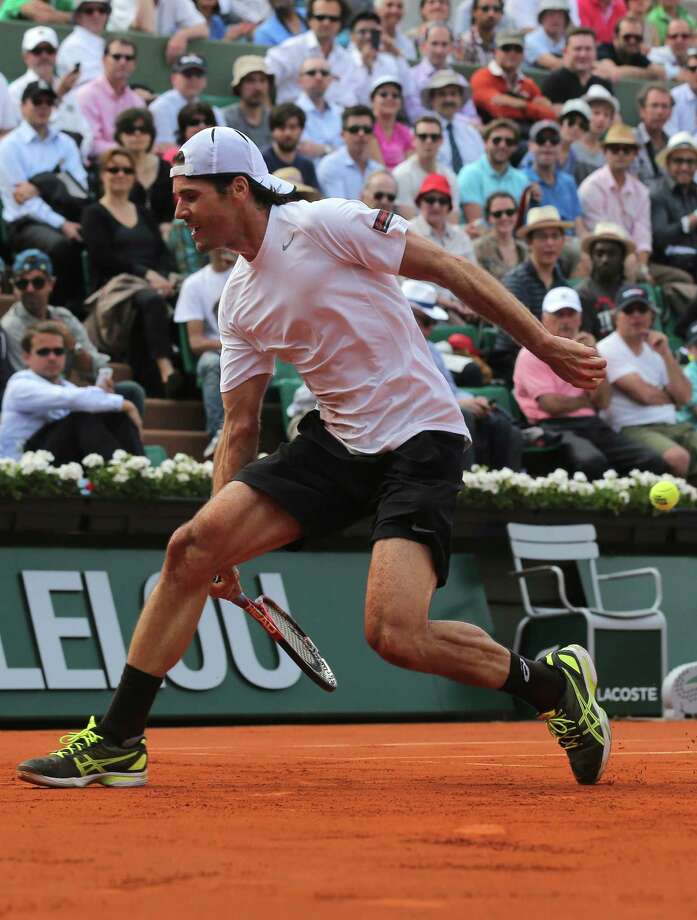 Germany's Tommy Haas makes an acrobatic return to Serbia's Novak Djokovic during their quarterfinal match of the French Open tennis tournament at the Roland Garros stadium Wednesday, June 5, 2013 in Paris. (AP Photo/Michel Euler) Photo: Michel Euler