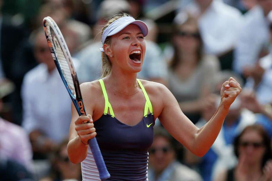 Russia's Maria Sharapova celebrates winning against Serbia's Jelena Jankovic in three sets 0-6, 6-4, 6-3, in their quarterfinal match at the French Open tennis tournament, at Roland Garros stadium in Paris, Wednesday June 5, 2013. (AP Photo/Petr David Josek) Photo: Petr David Josek