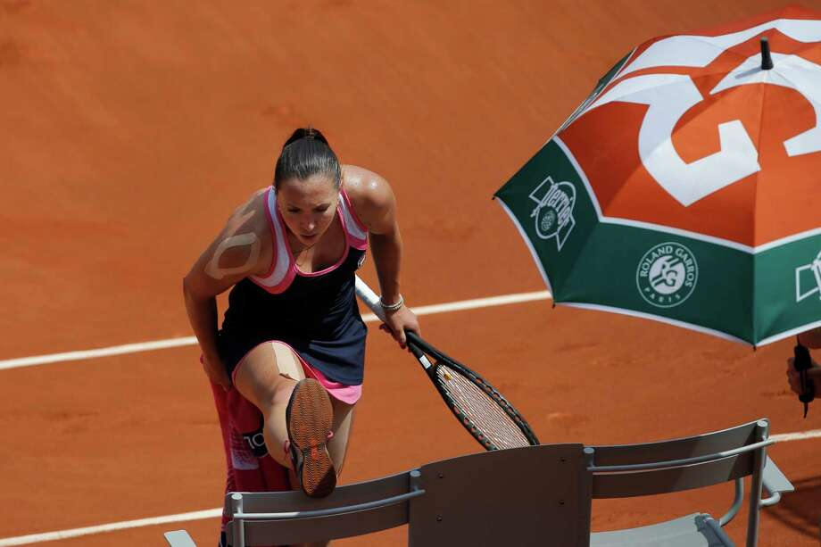 Serbia's Jelena Jankovic stretches in her quarterfinal match against against Russia's Maria Sharapova at the French Open tennis tournament, at Roland Garros stadium in Paris, Wednesday June 5, 2013. Sharapova won in three sets 0-6, 6-4, 6-3. (AP Photo/Christophe Ena) Photo: Christophe Ena