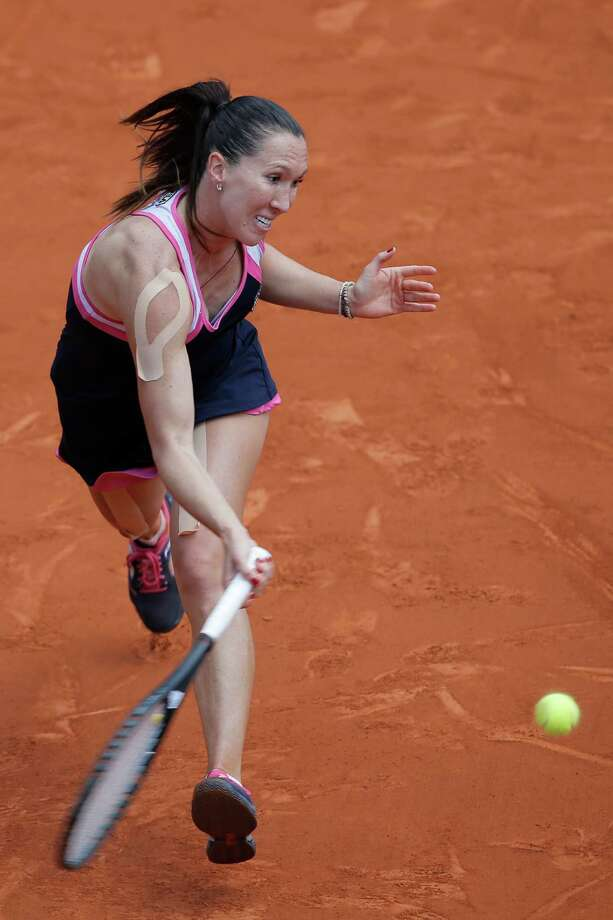 Serbia's Jelena Jankovic returns against Russia's Maria Sharapova in their quarterfinal match at the French Open tennis tournament, at Roland Garros stadium in Paris, Wednesday June 5, 2013. Sharapova won in three sets 0-6, 6-4, 6-3. (AP Photo/Christophe Ena) Photo: Christophe Ena