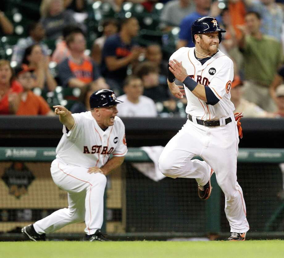 Trevor Crowe, right, had a green light from third-base coach Dave Trembley for one of the few runs scored that required actual running in a game that saw the Astros hit a season-high six home runs. Photo: Bob Levey, Stringer / 2013 Getty Images