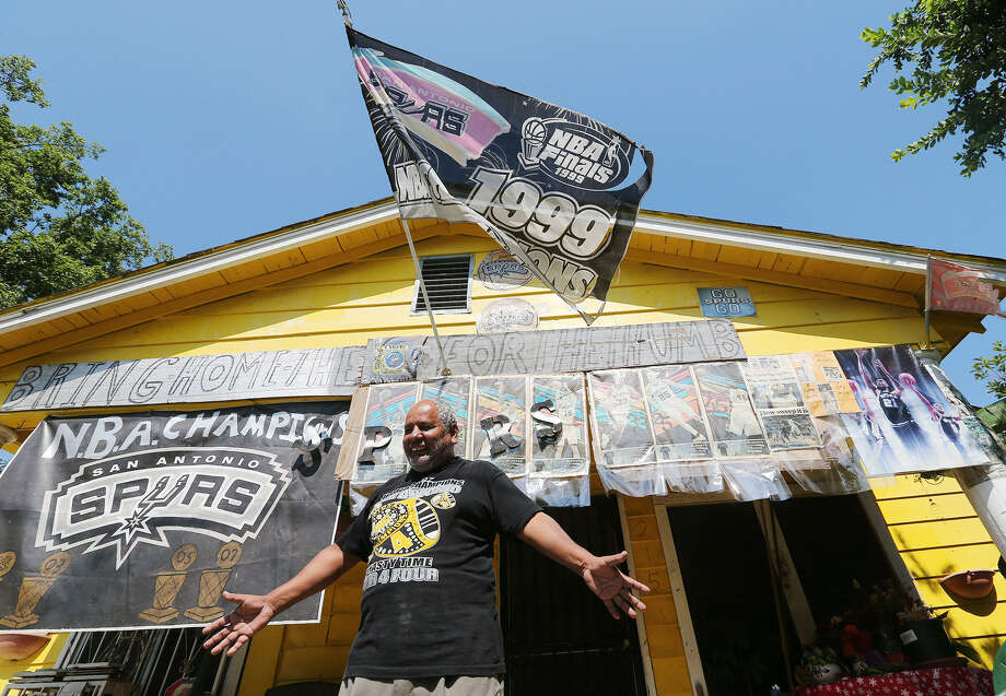 "Leonardo Flores has been decorating his home on Southwest 25th Street with Spurs memorabilia for more than 25 years. ""Everyone on the Spurs pitches in,"" the retired Fox Tech custodian said. ""They play as a team."" Photo: Photos By Jerry Lara / San Antonio Express-News"