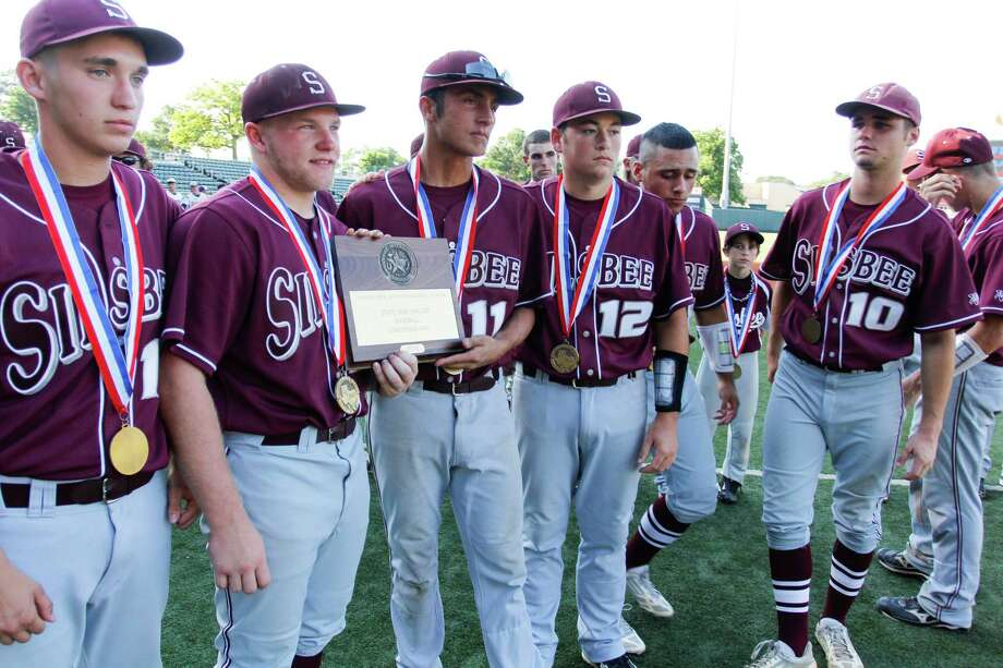 The Silsbee baseball team receives their semi-finalist medals after their 8-3 loss  against  La Grange in the Class 3A state semifinals  at UFCU Disch Falk Field in Austin. June 5, 2013. Valentino Mauricio/For The Enterprise Photo: Valentino Mauricio