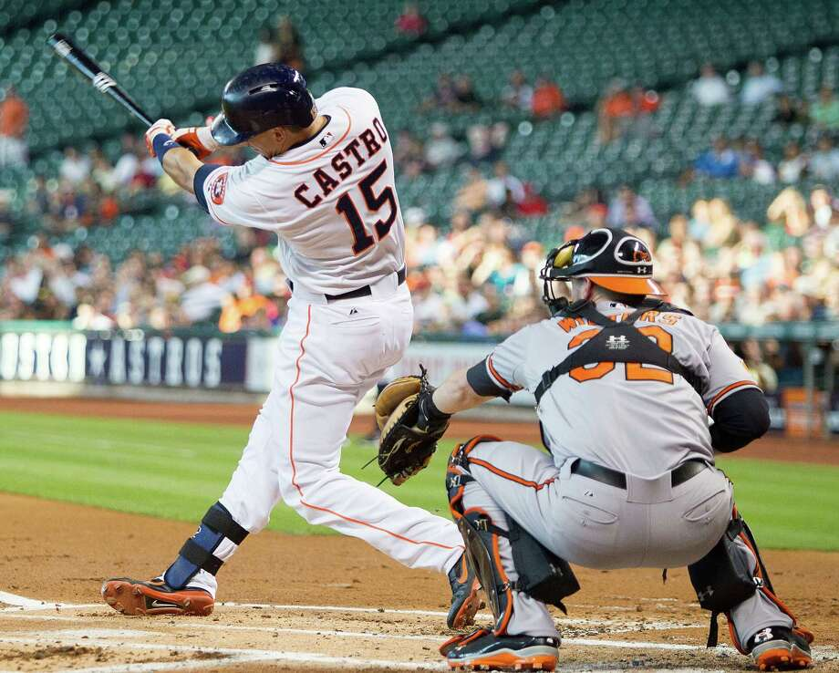 Jason Castro unloads on a first-inning home run, the first of six the Astros hit in Wednesday's victory, their seventh in eight games. Photo: Bob Levey, Stringer / 2013 Getty Images
