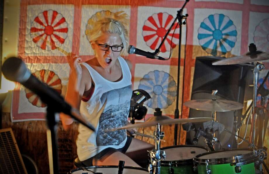 Drummer for Purple, Hannah Brewer, jams during practice on Wednesday, May 29, 2013. Photo taken: Randy Edwards/The Enterprise