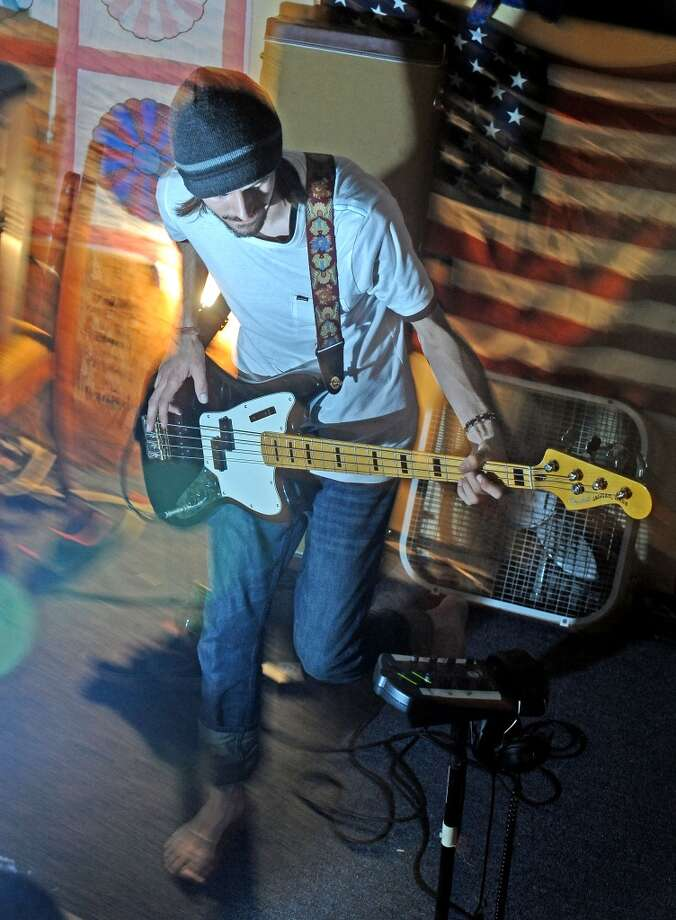 Bassist for Purple, Tyler Smith, jams during practice on Wednesday, May 29, 2013. Photo taken: Randy Edwards/The Enterprise