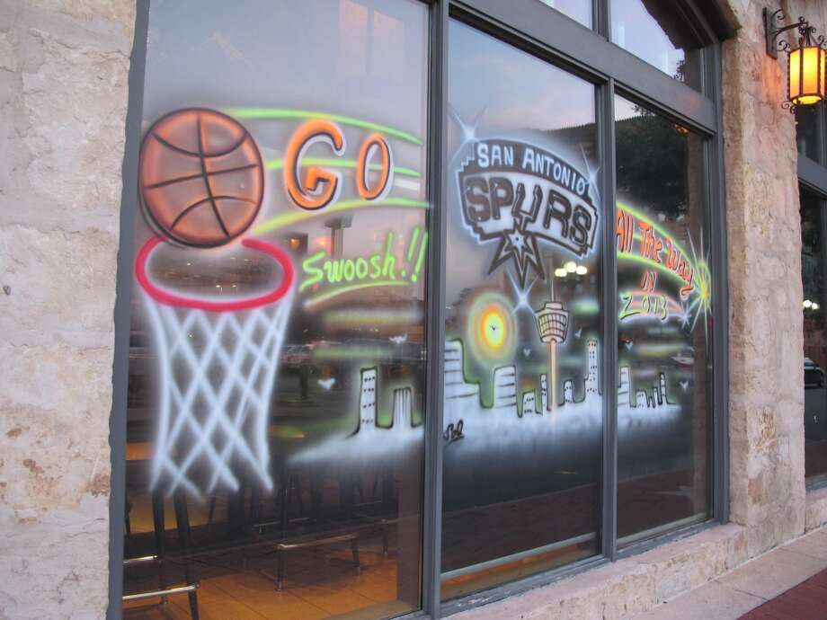 Barriba Cantina, 111 W. Crockett St., goes with a neon motif to show its Spurs spirit.