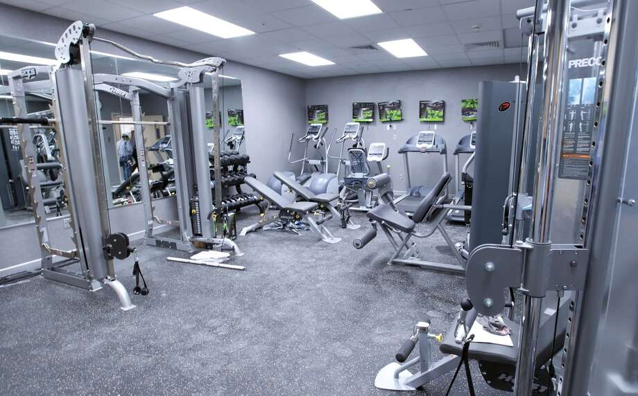 A workout room is crammed with fitness equipment inside the Shell off-shore drilling platform Olympus at the Kiewit Off-Shore Services site at Ingleside, Texas Wednesday, June 5, 2013. Photo: George Tuley, For The Houston Chronicle
