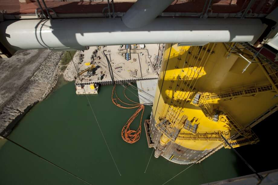 At the foot on one of the four legs of the Shell off-shore drilling platform Olympus at the Kiewit Off-Shore Services site are containment booms pre-deployed in the event of any spills at Ingleside, Texas Wednesday, June 5, 2013. Photo: George Tuley, For The Houston Chronicle