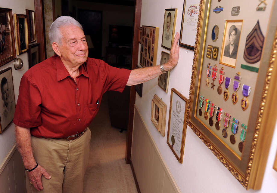 Arlie Ray Horn of Beaumont looks over the medals he received from the US Army after serving in World War II. Horn was awarded three Purple Hearts and fought on Omaha Beach on D-Day.   Photo taken Wednesday, June 05, 2013 Guiseppe Barranco/The Enterprise Photo: Guiseppe Barranco, STAFF PHOTOGRAPHER / The Beaumont Enterprise