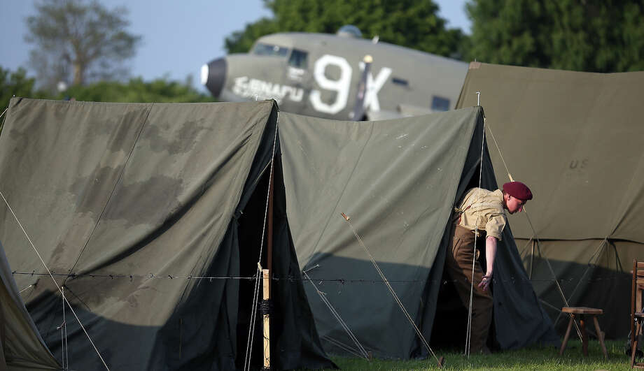 A man dressed as a British Second World War soldier leaves a tent at the Merville Gun Battery on June 5, 2013 near Caen, France. Across Normandy several hundred of the surviving veterans of the Normandy campaign are gathering to commemorate the 69th anniversary of the D-Day landings which eventually led to the Allied liberation of France in 1944. Next year, which will mark the 70th anniversary of the landings, is widely expected to be the last time that the veterans will gather in any great number. Photo: Matt Cardy, Getty Images / 2013 Getty Images