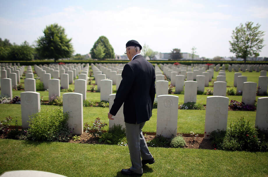 Normandy Veteran 90-year-old Bob Barker looks at the headstones of fallen comrades at a remembrance and wreath laying ceremony to commemorate the start of the D-Day landings at Bayeux War Cemetery on June 6, 2013 in Bayeux, France. Across Normandy several hundred of the surviving veterans of the Normandy campaign are gathering to commemorate the 69th anniversary of the D-Day landings which eventually led to the Allied liberation of France in 1944. Next year, which will mark the 70th anniversary of the landings, is widely expected to be the last time that the veterans will gather in any great number. Photo: Matt Cardy, Getty Images / 2013 Getty Images