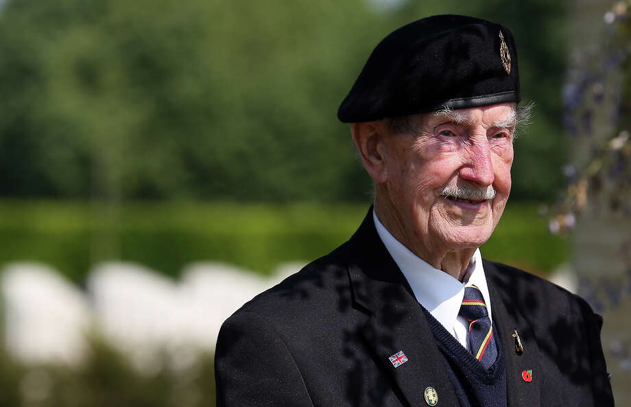 A Normandy Veteran, stands in the shade at a remembrance and wreath laying ceremony to commemorate the start of the D-Day landings at Bayeux War Cemetery on June 6, 2013 in Bayeux, France. Across Normandy several hundred of the surviving veterans of the Normandy campaign are gathering to commemorate the 69th anniversary of the D-Day landings which eventually led to the Allied liberation of France in 1944. Next year, which will mark the 70th anniversary of the landings, is widely expected to be the last time that the veterans will gather in any great number. Photo: Matt Cardy, Getty Images / 2013 Getty Images