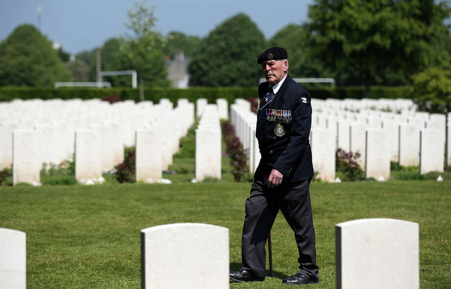 Normandy Veteran, Major Edwin Hunt, looks at the headstones of fallen comrades at a remembrance and wreath laying ceremony to commemorate the start of the D-Day landings at Bayeux War Cemetery on June 6, 2013 in Bayeux, France. Across Normandy several hundred of the surviving veterans of the Normandy campaign are gathering to commemorate the 69th anniversary of the D-Day landings which eventually led to the Allied liberation of France in 1944. Next year, which will mark the 70th anniversary of the landings, is widely expected to be the last time that the veterans will gather in any great number. Photo: Matt Cardy, Getty Images / 2013 Getty Images