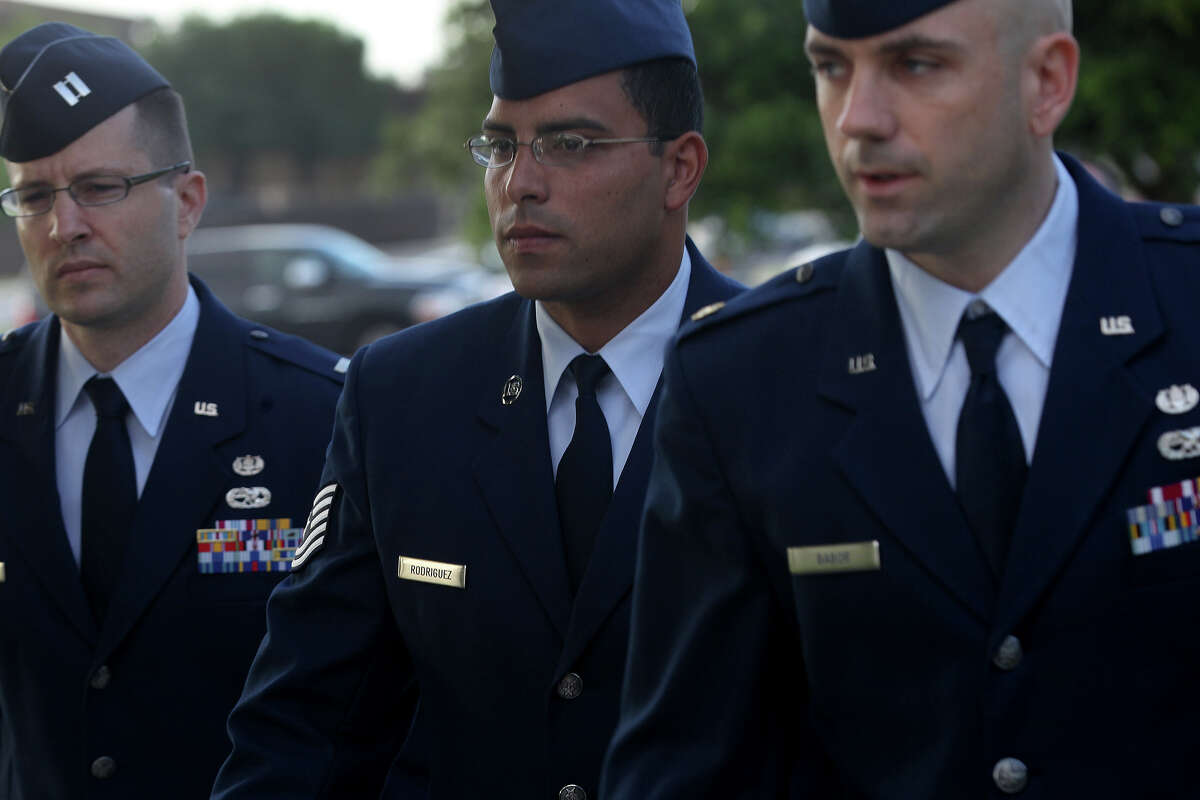 Air Force Tech Sergeant Jaime Rodriguez (center) heads for court Thursday June 6, 2013 at Joint Base San Antonio-Lackland. He is accused of having illicit contact with 18 women, and having sex with four of them.