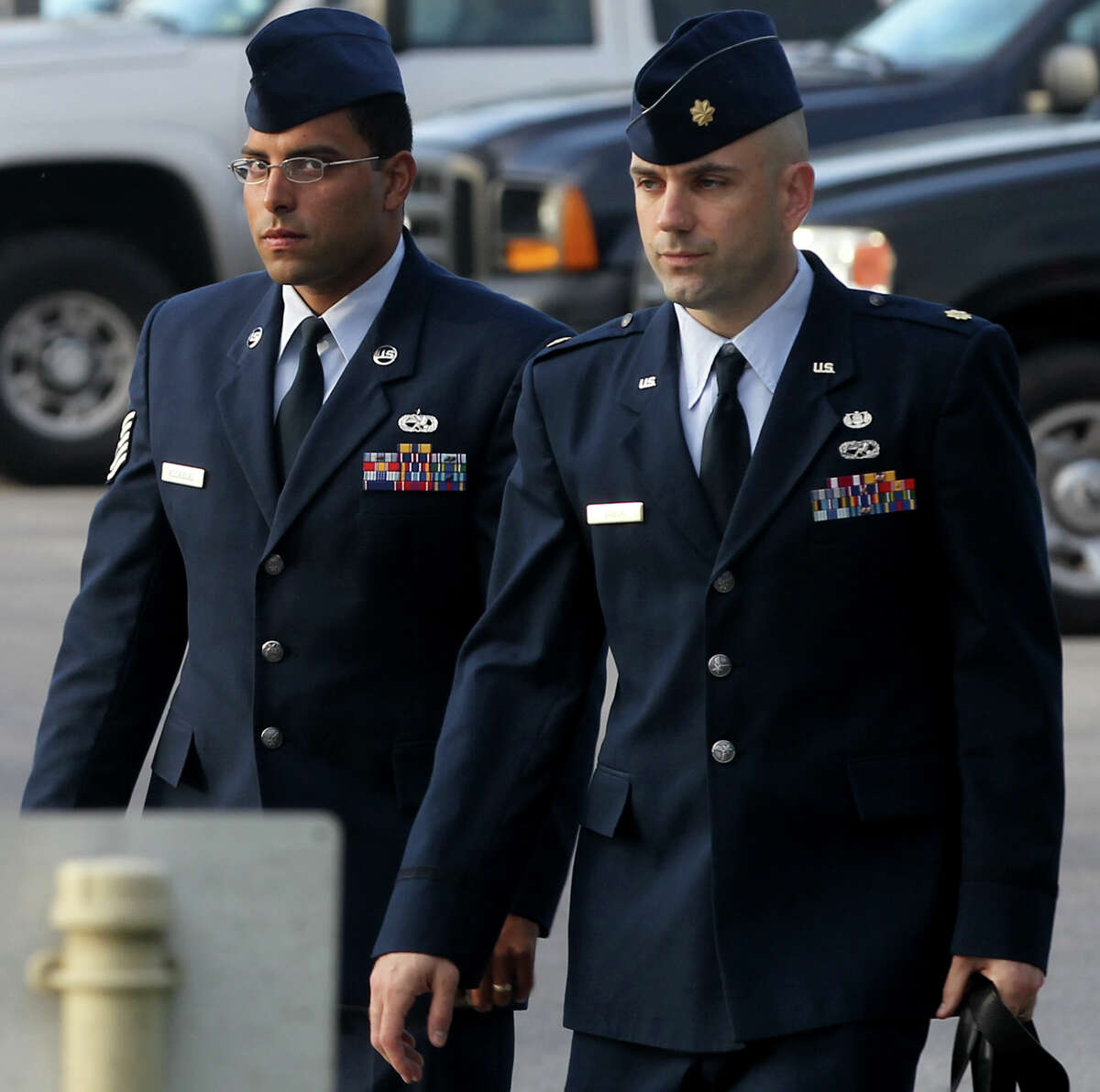 Air Force Tech Sergeant Jaime Rodriguez (left) heads for court Thursday June 6, 2013 at Joint Base San Antonio-Lackland. He is accused of having illicit contact with 18 women, and having sex with four of them.