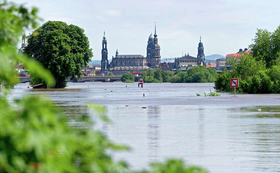 TOPSHOTS High tide scale of the river Elbe is seen in Dresden, eastern Germany, on June 5, 2013. Chancellor Angela Merkel pledged 100 million euros in emergency aid for flood-ravaged areas as surging waters that have claimed at least 11 lives and forced tens of thousands of evacuations across central Europe bore down on eastern Germany.  AFP PHOTO / ROBERT MICHAELROBERT MICHAEL/AFP/Getty Images Photo: ROBERT MICHAEL, AFP/Getty Images / AFP