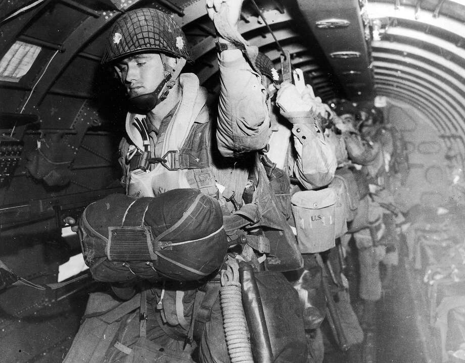 D-Day:American paratroopers (either 82nd or 101st Division) attached to the static line just prior to jumping during the invasion of Normandy, France. Photo: US Army Air Force, Time & Life Pictures/Getty Image / Time & Life Pictures