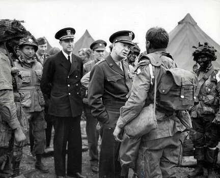 """D-Day: General Dwight D, Eisenhower gives the order of the day """"Full victory, Nothing Else"""" to paratroopers before they board their airplanes to participate in the first assault in the Allied invasion of France. Photo: Popperfoto, Popperfoto/Getty Images / Popperfoto"""