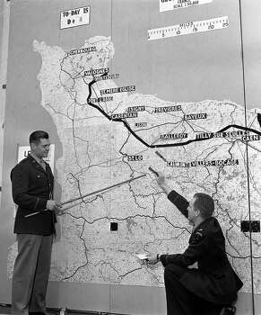 June, 15, 1944: Press Correspondents are briefed by officers with maps showing advances into France. Photo: Popperfoto, Popperfoto/Getty Images / Popperfoto