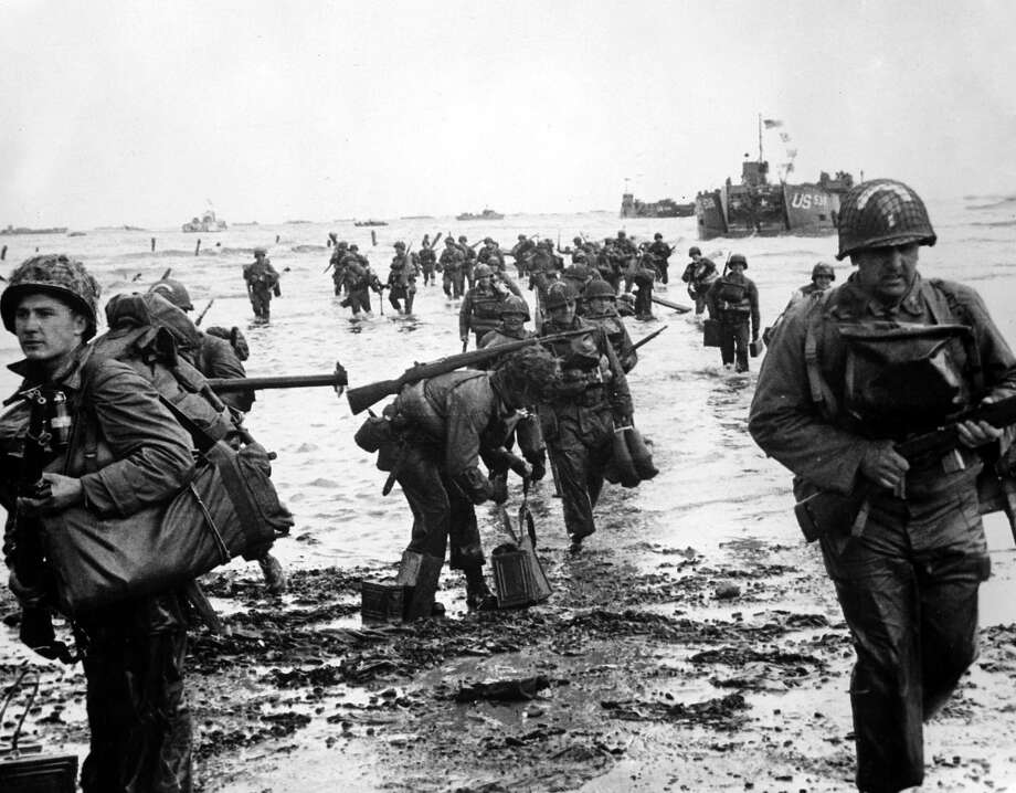 D-Day:American troops arrive on a French beach on D-Day during the invasion of Europe. Photo: Popperfoto, Popperfoto/Getty Images / Popperfoto