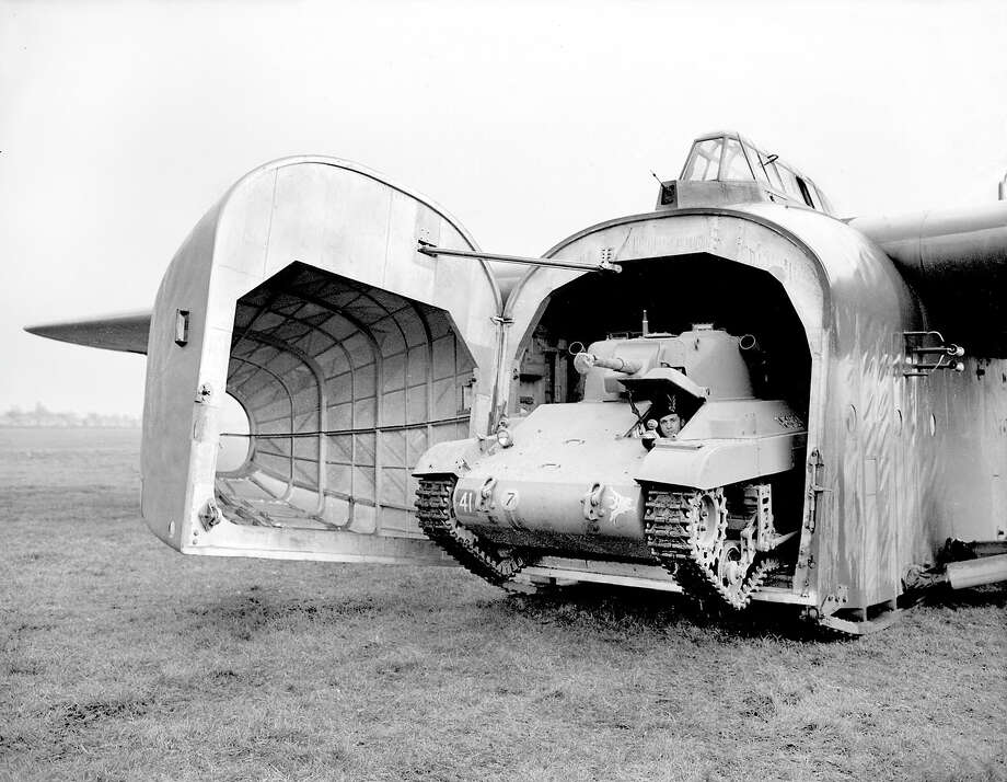 December, 14 1944: The largest wooden aircraft in the world, is towed by four-engine bombers at 150 mpg, and weighs 16 tons fully laden. It typical loaded one tank, two Bren carriers, and a self-propelled Bofors gun or two armored scout cars, which can be in action within fifteen seconds of the glider coming to rest. Photo: Planet News Archive, SSPL Via Getty Images / SSPL/Planet News Archive