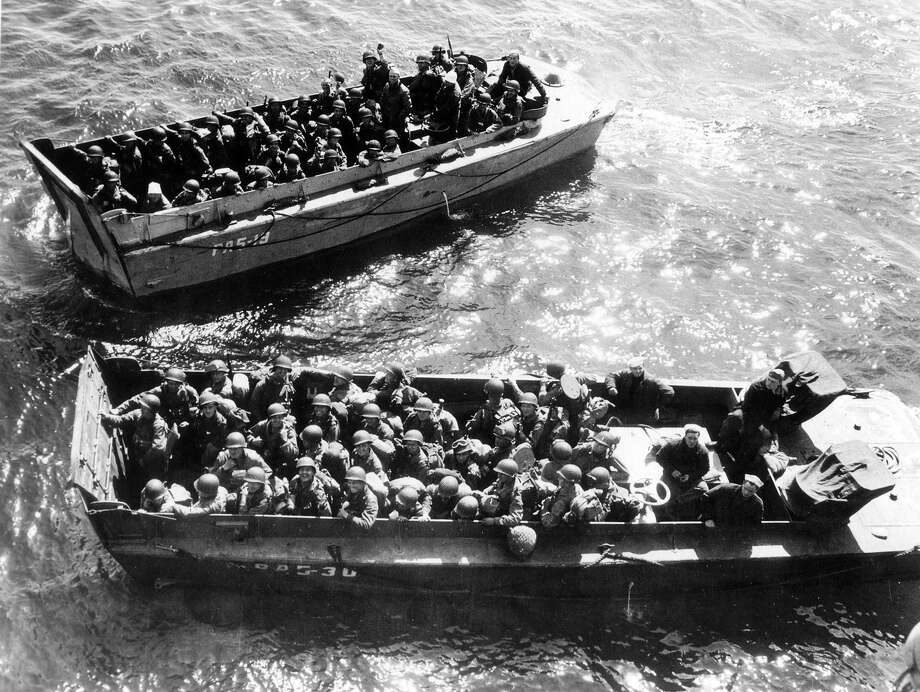 D-Day:American troops in full battle equipment set out in landing craft from England's shores enroute to the Normandy beaches. Photo: UniversalImagesGroup, UIG Via Getty Images / Universal Images Group Editorial