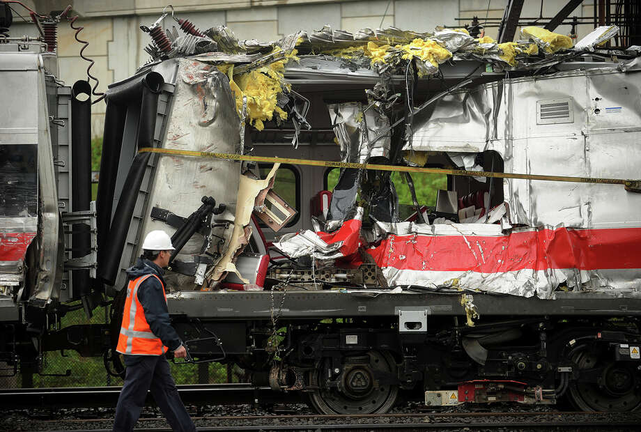 A mangled Metro North Railroad car sits on the tracks after a derailment and collision in Bridgeport on May 17, 2013. Investigators now say a track defect had been flagged before the derailment. Photo: Brian A. Pounds / Connecticut Post