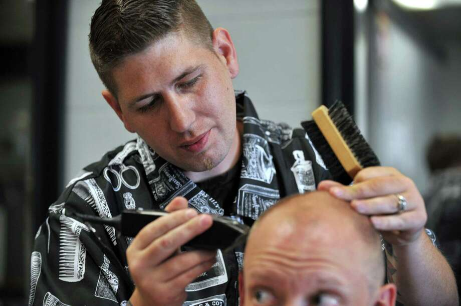 Gary R. Haggas, 32, owner of Gary's Barber Shop in Brookfield, Conn., gives Mark Nobes, 31, of Brookfield, a haircut, Friday, May 31, 2013. Photo: Carol Kaliff / The News-Times
