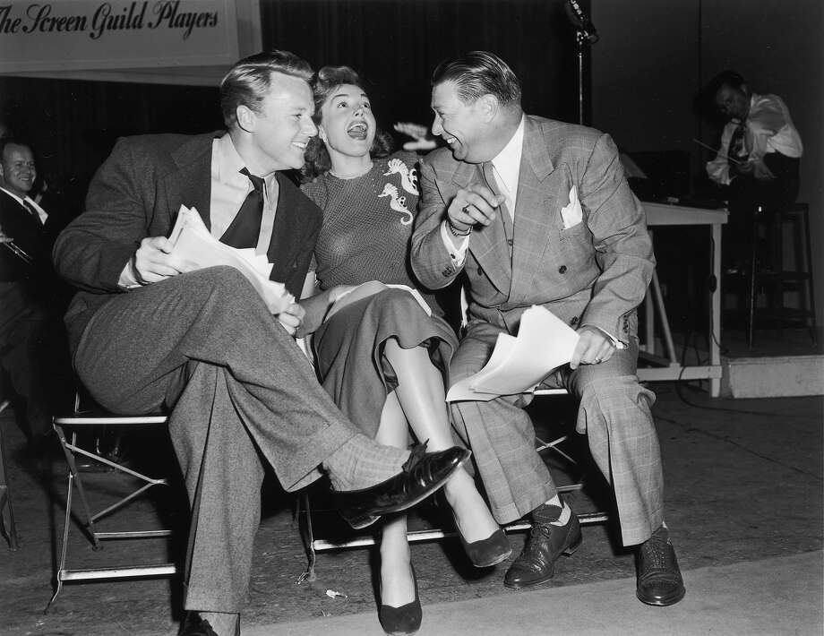 American actors Van Johnson and Esther Williams and an unidentified man joke around while sitting in the studio for a radio recording session with the Screen Guild Players, Screen Actors Guild in 1948. Photo: Gene Lester, Getty Images / Archive Photos