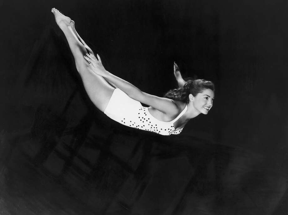 Portrait of aquatic American actor and swimmer Esther Williams diving through the air in a one-piece swimsuit in 1945. Photo: Hulton Archive, Getty Images / Archive Photos