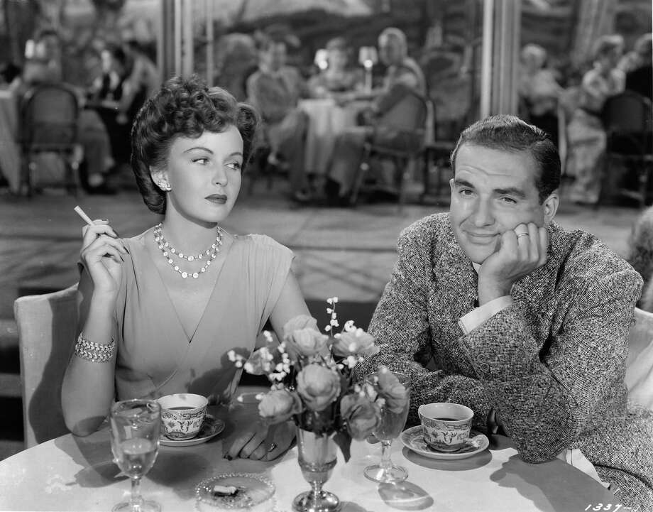 Esther Williams looking over at Donald Curtis at the table in a scene from the film 'Thrill Of A Romance', 1945. Photo: Archive Photos, Getty Images / 2012 Getty Images